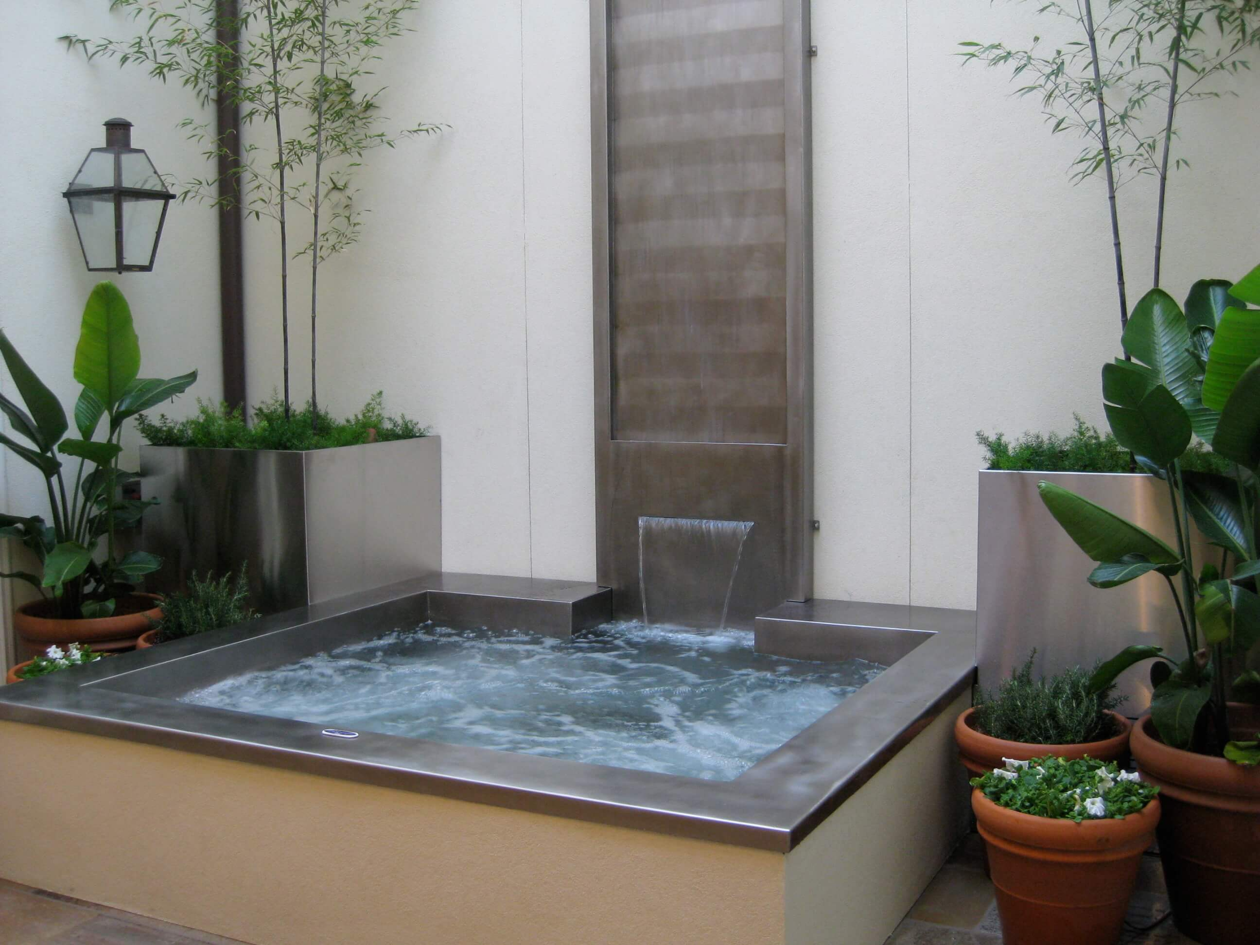 We worked alongside Diamond Spas to transform this beautiful Country Club Place  townhome's quaint, interior courtyard into a modern oasis, complete with a floor-to-ceiling fountain and spa.